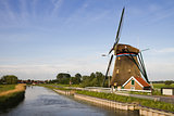 Dutch windmill and country road