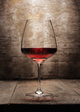 Red wine glass on wooden background