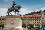 Statue of King Joao I at Figueiroa Square and St. Jorge Castle i