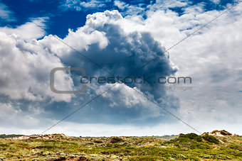 Amazing Clouds above Green Meadow in Guincho Beach near Lisbon,