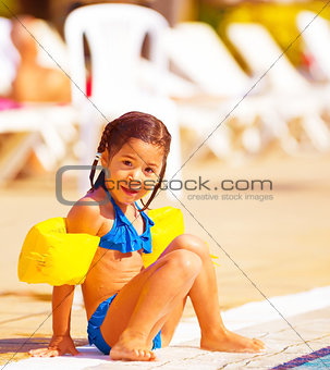 Little girl near pool