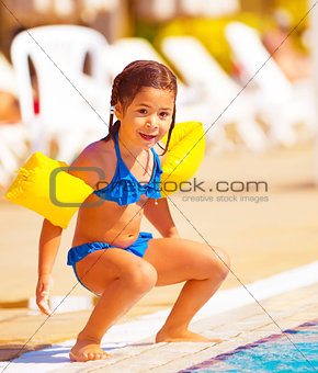 Little girl preparing to jump into water