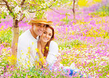 Woman and man on floral field