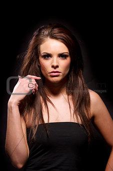 Beautiful brunette woman on a black background