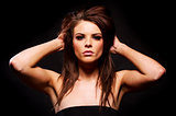 Beautiful brunette woman on a black background