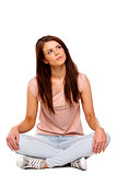 Brunette woman sat crossed legged thinking