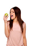 Brunette woman biting into an apple