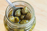 spoon in jar of pickled capers