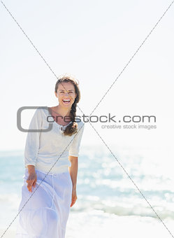 Portrait of smiling young woman at seaside