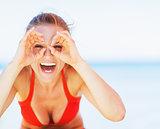 Happy young woman on beach having fun