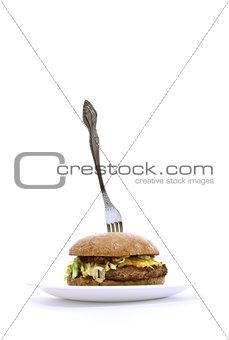 fork stuck in a fat sandwich