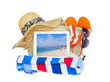 sunbathing accessories  with sea on tablet