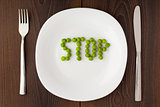 Word stop made of peas on a plate