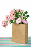 pink roses in brown bag