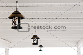 three metal lamps are suspended