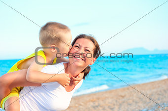 son kissing and hugging her mother