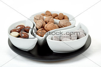 almonds in chocolate and walnuts on white