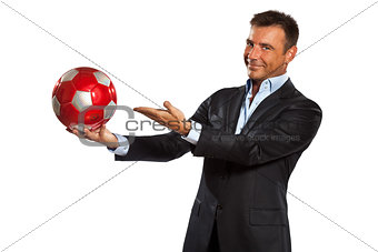 one business man holding showing a soccer ball