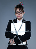 business woman chained to her  her computer laptop