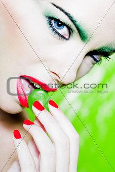 Woman Portrait eating a grape