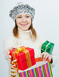 attractive girl in a sweater holding a gift