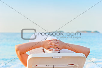 woman sunbathing on a lounger