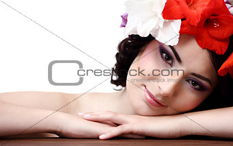 Beautiful young woman with flowers in their hair looks at the ca
