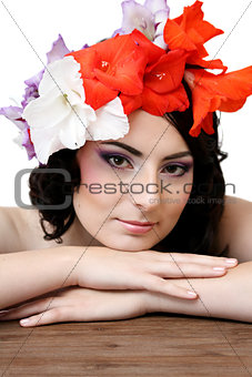 Beautiful young woman with flowers in their hair
