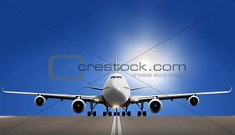 Air plane on runway with bright sun and blue sky