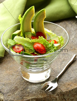 salad with avocado and cherry tomatoes
