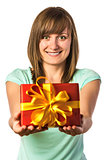 Happy young girl holding present