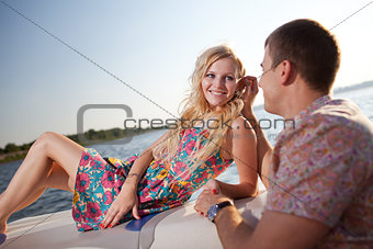 young couple on the boat