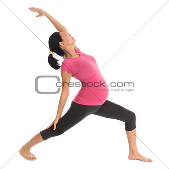 Asian pregnant yoga exercise.