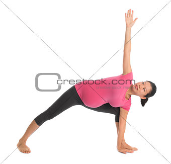 Asian pregnant yoga stretching.
