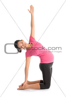 Asian pregnant yoga position.