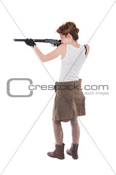 Young woman having rifle