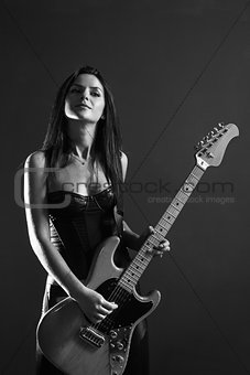 Beautiful female guitar player black and white