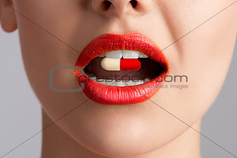 beauty female lips with pill