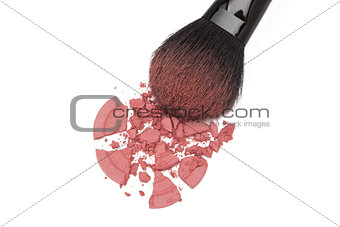 Crushed rouge with makeup brush