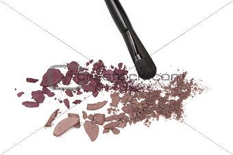 Crushed eyeshadow with makeup brush