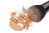 Crushed cosmetic powder with makeup brush