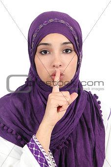 Beautiful islamic woman wearing a hijab asking for silence
