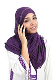 Beautiful arab woman wearing a hijab on the phone