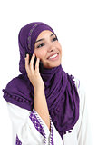 Beautiful muslim woman wearing a hijab talking on the mobile phone