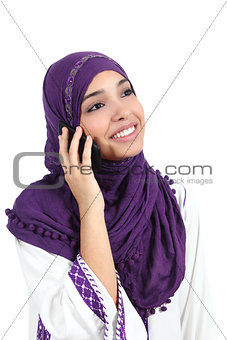 Beautiful muslim woman wearing a hijab talking on the mobile phone