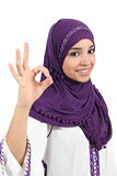 Beautiful muslim woman wearing a hijab gesturing ok