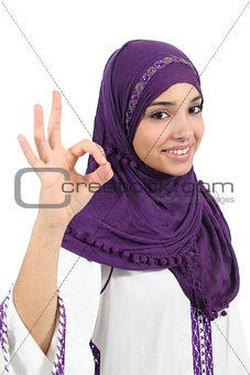 Beautiful muslim woman wearing a hijab gesturing ok