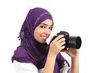 Arab woman wearing a hijab taking a photography