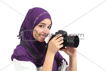 Arab woman wearing a hijab taking a photography
