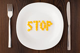 Word stop made of corn seeds on a plate